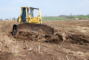 Using the bulldozer to ready fields for spring planting